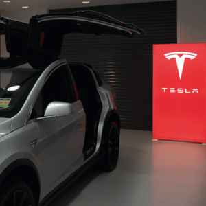 The Portable Backlit Bannerstand in a Tesla showroom.