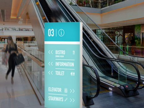 Portable backlit bannerstand near escalators