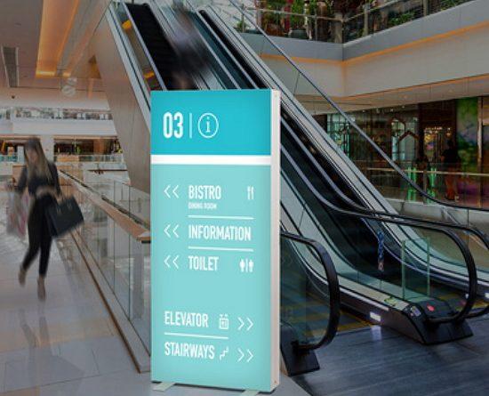Portable backlit bannerstand near escalators